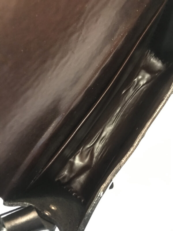 Ledertasche schwarz mit Verzierungen